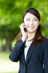 asian businesswoman using smart phone