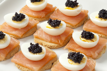 Snack with salmon,quail eggs and lumpfish roe