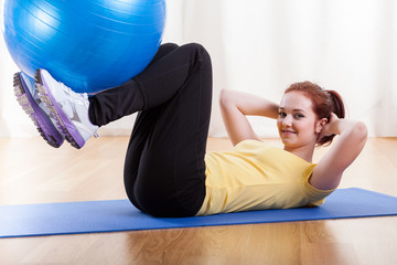 Girl exercising with gym ball