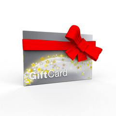 Shiny silver and gold stars gift card wrapped in red bow