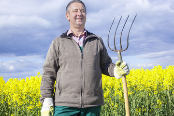 Farmer with fork on the field