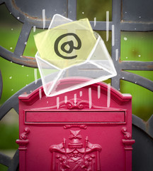 Envelope with email sign dropping into mailbox