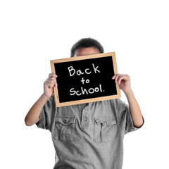 Asian boy holding with Back to school message on black board