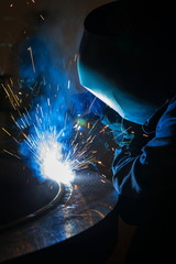 Welder worker is welding a big valve  body