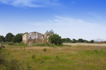 Derelict old farmhouse in countryside