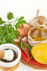 Fresh cooking ingredients with olive oil