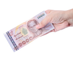 Hand holding Thai money isolated on white.