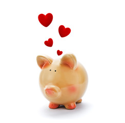 Piggy bank with red hearts above