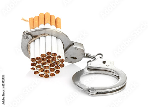 canvas print picture Addition concept with cigarettes and handcuffs