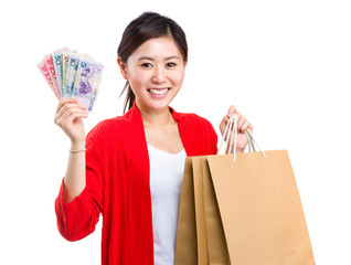 Girl with shopping bag and cash money
