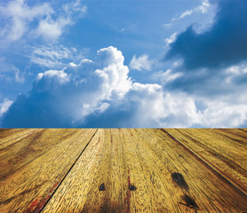 Wood texture with clouds and sky background