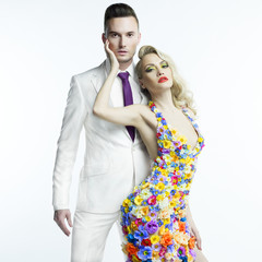 Young man and beautiful lady in flower dress