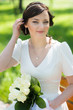 Portrait of beautiful bride sitting on the bench
