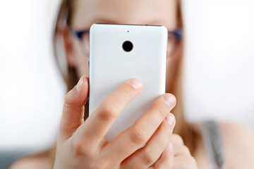 phone in the child hand