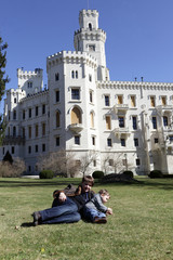 Family on the lawn in front of the castle