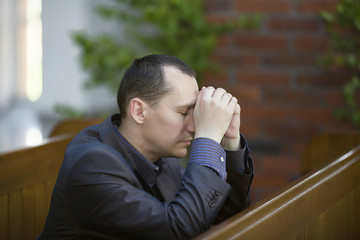 Man pray to God in the church