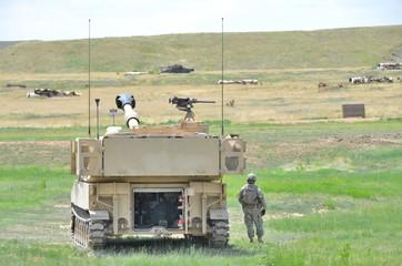 Soldier next to Howitzer