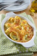 Baked lumaconi with ricotta and spinach