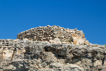 Ancient stone talayot at Menorca island, Spain.