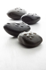 Wet black massage stones