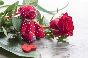 red rose bouquet with red Teddy bear