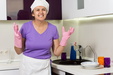 Frustrated cook wringing her hands in desperation