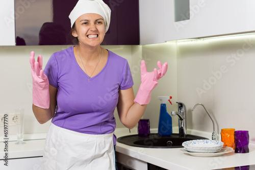 Frustrated cook wringing her hands in desperation
