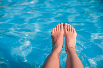 Close-up of a woman's foot in the water