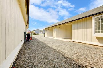 House backyard. View of garage and driveway