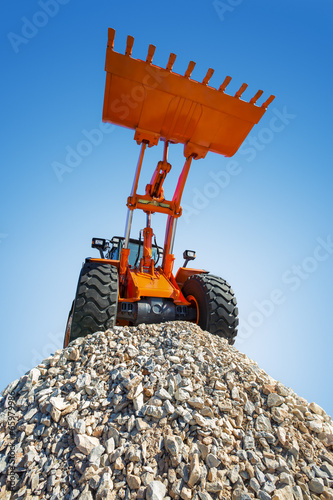 canvas print picture Excavator on the top