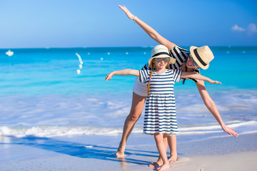 Young mother with her daughter enjoy vacation on caribbean beach