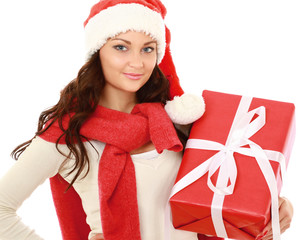 Smiling girl in santa hat with bag full of xmas gift isolated on