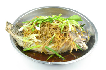 Steamed fish with soy sauce  isolated on a white background