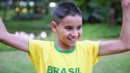 Brazilian Boy celebrates in the park