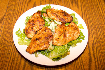 Lettuce and cucumber salad with barbecue chicken