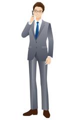 若いビジネスマン 携帯電話