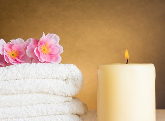 Spa massage border background with towel stacked and candle