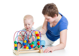 child boy and mother play with color educational toy