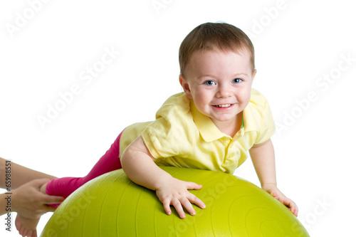 kid on gymnastic ball