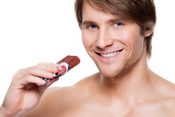 Handsome smiling man with chocolate bar.