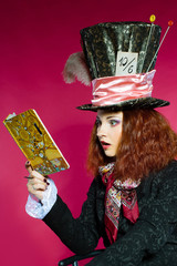 Portrait of young woman in the similitude of the Hatter reading