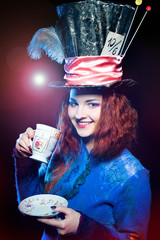 Portrait of young woman in the similitude of the Hatter drinking