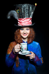 Portrait of young woman in the similitude of the Hatter with cup