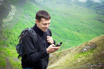 Male tourist holding GPS