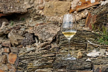 Glass of Riesling wine on slate rock