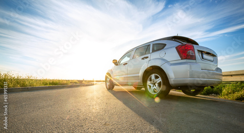 canvas print picture car on road over sunny day