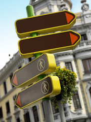 Signpost and antique building in Madrid