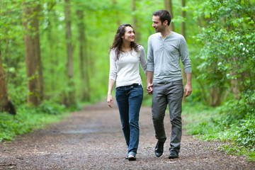 Young couple having a walk in a forest