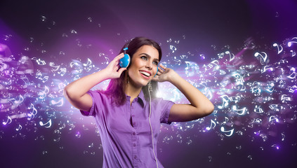 Pretty young woman with headphones listening to music