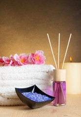 Spa massage with towel, perfume diffuser and sea salt